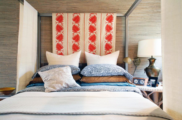 Cocooned in Grasscloth, this Bedroom is a Nobel Retreat"